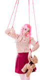 Woman girl stylized like marionette puppet on string Royalty Free Stock Photography