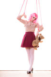 Woman girl stylized like marionette puppet on string Stock Images