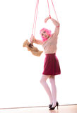 Woman girl stylized like marionette puppet on string. Mental disorder concept. Young woman girl stylized like marionette puppet on string with teddy bear toy Stock Photography