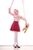 Woman girl stylized like marionette puppet on string. Mental disorder concept. Young woman girl stylized like marionette puppet on string with teddy bear toy Stock Photos