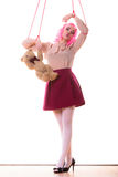 Woman girl stylized like marionette puppet on string. Mental disorder concept. Young woman girl stylized like marionette puppet on string with teddy bear toy Royalty Free Stock Photography