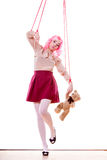 Woman girl stylized like marionette puppet on string. Mental disorder concept. Young woman girl stylized like marionette puppet on string with teddy bear toy Royalty Free Stock Photos