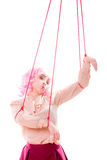 Woman girl stylized like marionette puppet on string Stock Photo