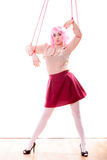 Woman girl stylized like marionette puppet on string Stock Photography