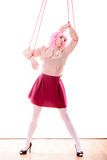 Woman girl stylized like marionette puppet on string Stock Photos