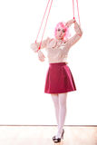Woman girl stylized like marionette puppet on string. Young woman girl stylized like marionette puppet on string Royalty Free Stock Photography