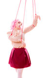 Woman girl stylized like marionette puppet on string. Young woman girl stylized like marionette puppet on string Royalty Free Stock Image