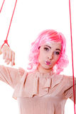 Woman girl stylized like marionette puppet on string. Young woman girl stylized like marionette puppet on string Stock Photography