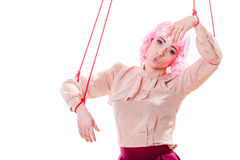 Woman girl stylized like marionette puppet on string. Young woman girl stylized like marionette puppet on string Stock Photo
