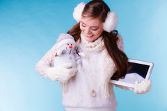 Woman girl with tablet and little snowman. Winter. Royalty Free Stock Photos