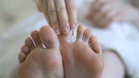 Woman girl taking care of her dry foot skin applying moisturizing cream. Skincare. Closeup of female feet stock video