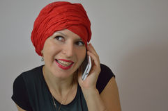 Beautiful Gypsy - Eastern woman in red turban, gir Stock Image