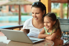 Woman with girl using laptop Royalty Free Stock Images
