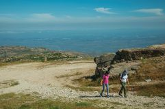 Woman and girl walking up in a trail on highlands. Serra da Estrela, Portugal - July 12, 2018. Woman and girl walking up in a trail on highlands at the Serra da royalty free stock photos