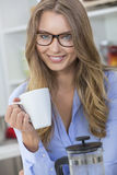 Woman Girl Wearing Glasses Drinking Tea or Coffee Royalty Free Stock Images