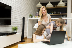 Woman with girls at home Royalty Free Stock Photo