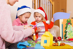 Woman with  girls preparing for Christmas Stock Photos