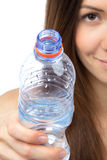 Woman give drinking bottle of water Stock Images