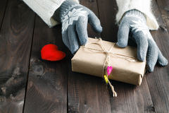 Woman give red heart and present Stock Photo