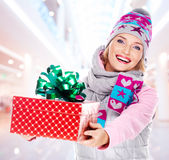 Woman gives the christmas  gift Royalty Free Stock Images