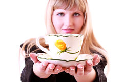 Woman gives a cup of tea isolated Royalty Free Stock Photography