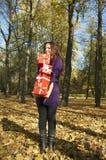 Woman gives a gift Stock Photos