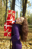 Woman gives a gift Stock Photography