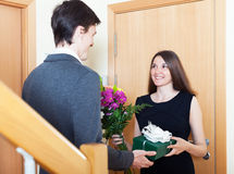 Woman gives a guy a  present Royalty Free Stock Photos