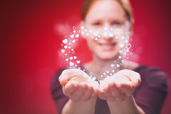 Woman Gives a Heart as a Gift Royalty Free Stock Images