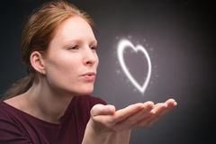 Woman Gives a Heart in a Kiss Stock Photos