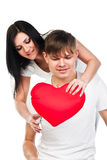 Woman gives a man a heart Royalty Free Stock Image