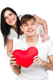 Woman gives a man a heart Stock Photography