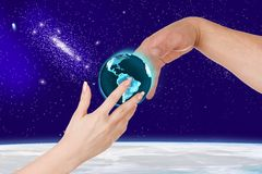 Woman gives a man planet Earth Royalty Free Stock Images