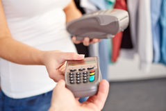 Woman gives men a payment terminal Stock Image