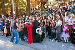 Woman Gives Out Candy At Halloween Parade Royalty Free Stock Image