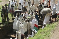 A woman gives some food to parishioners at the end of a religious ceremony in Lalibela. Ethiopia.