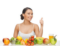 Woman gives thumbs up with fruits and vegetables Royalty Free Stock Photography
