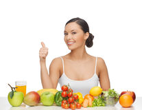Woman gives thumbs up with fruits and vegetables Stock Images