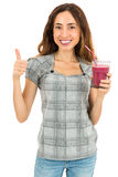 Woman gives thumbs up for the smoothie Royalty Free Stock Photo