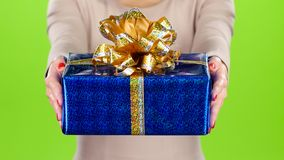 Woman gives to a box with a gift. Pleasant surprise. stock footage