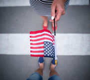 Woman giving american flag to a man Stock Photo
