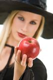 Woman giving apple Royalty Free Stock Photos