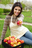 Woman giving apple at you Royalty Free Stock Photos