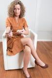 Woman giving back pills Stock Image