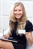 Woman giving blank business card Stock Image