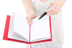 Woman giving blank notebook and pen isolated on white Stock Image