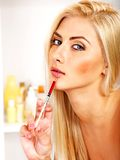 Woman giving botox injections. Royalty Free Stock Images