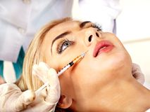 Woman giving botox injections. Beauty woman giving botox injections royalty free stock image