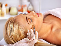 Woman giving botox injections. Stock Photography