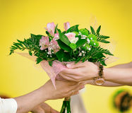 Woman giving bouquet of flowers. Royalty Free Stock Image